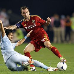 KANSAS CITY, KS - APRIL 14:  Paulo Nagamura #6 of Sporting Kansas City battles Jonny Steele #22 of Real Salt Lake during the Major League Soccer game on April 14, 2012 at Livestrong Sporting Park in Kansas City, Kansas.  (Photo by Jamie Squire/Getty Images)