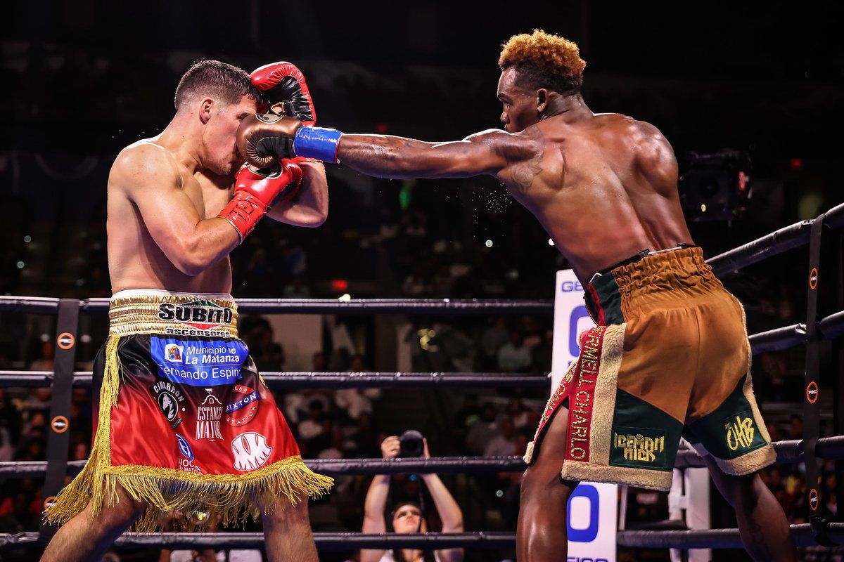 Jermell Charlo jabs Brian Castano in their junior middleweight undisputed title fight.