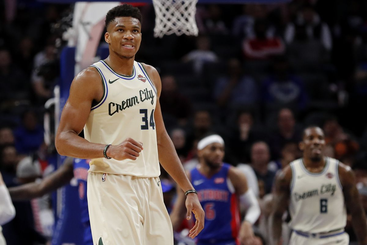 Milwaukee Bucks forward Giannis Antetokounmpo ) reacts during the first half against the Detroit Pistons at Little Caesars Arena.
