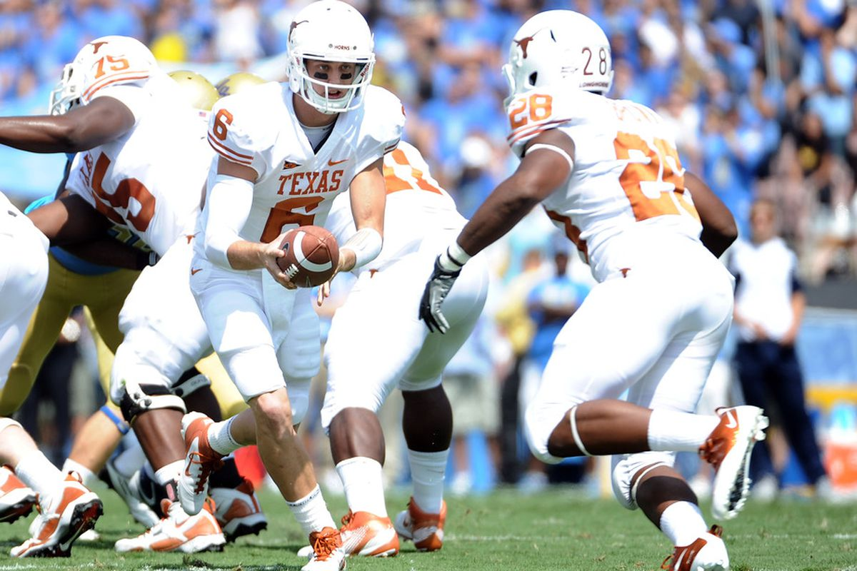 PASADENA, CA - SEPTEMBER 17:  Case McCoy #6 of the Texas Longhorns handsoff to Malcolm Brown #28 of the Texas Longhorns during the first quarter at Rose Bowl on September 17, 2011 in Pasadena, California.  (Photo by Harry How/Getty Images)