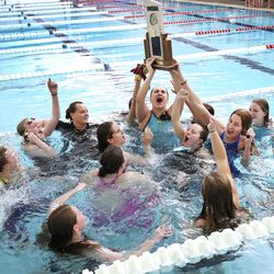 Lone Peak swimmers celebrate their team win in the 6A girls swim championship at Kearns Oquirrh Park Fitness Center in Kearns on Saturday, Feb. 20, 2021.