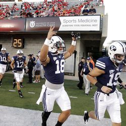 Brigham Young players run on to the field prior to the Utah game in Salt Lake City  Saturday, Sept. 15, 2012.