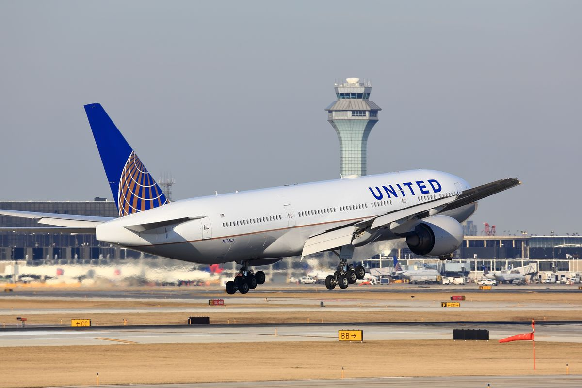 An airliner hovers above a runway as its makes a landing at Chicago's O'Hare International Airport.