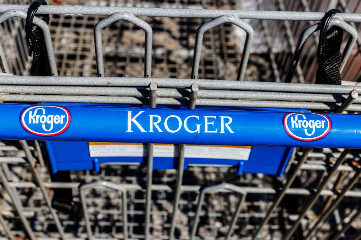 """Handle of a grocery cart reading """"Kroger"""""""