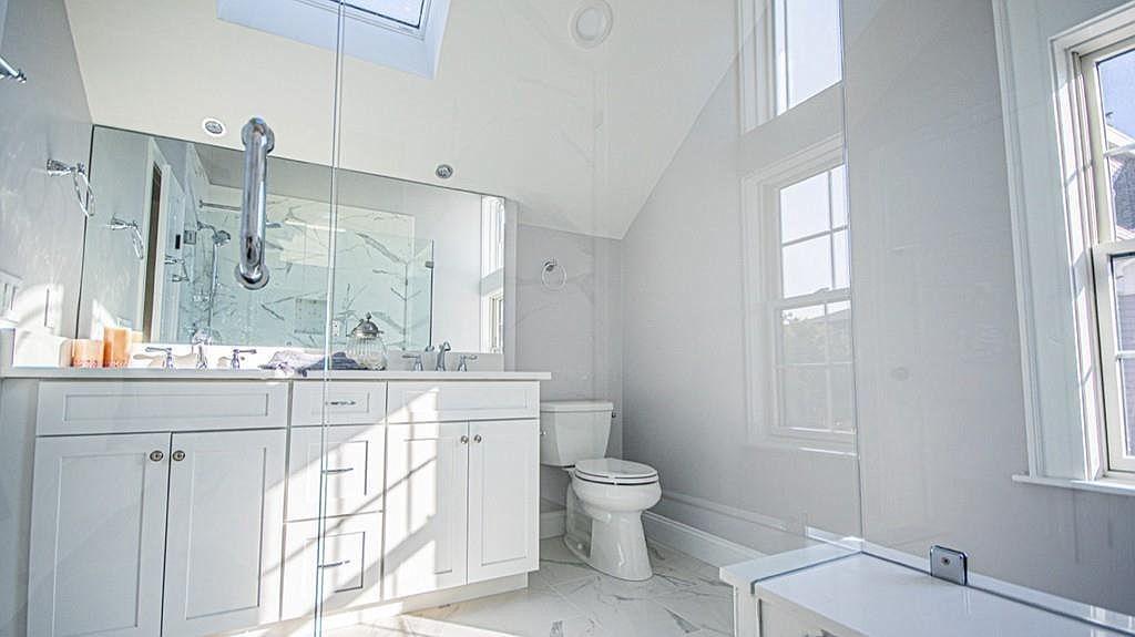A spacious, skylighted bathroom.