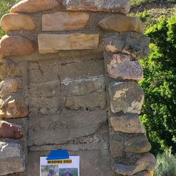The monument at the mouth of Emigration Canyon denoting Donner Hill has lost its plaque, replaced with a sign for a missing dog.