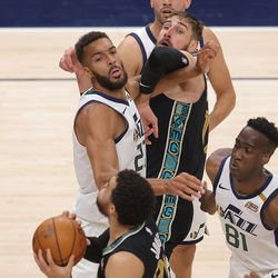 Memphis Grizzlies center Jonas Valanciunas (17) grabs Utah Jazz center Rudy Gobert (27) as the Utah Jazz and the Memphis Grizzlies play in game one of their NBA playoff series at Vivint Arena in Salt Lake City on Sunday, May 23, 2021. Memphis won 112-109.