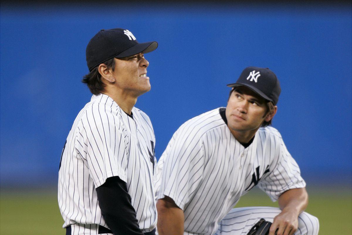 New York Yankees' Johnny Damon comes to the aid of Hideki Ma