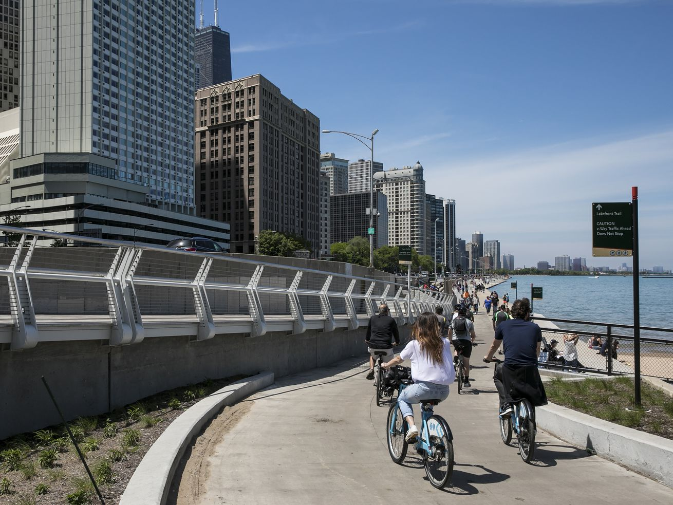People walk and ride bicycles on the Lakefront Trail near the Navy Pier Flyover Project construction zone on Saturday morning, May 27, 2017.