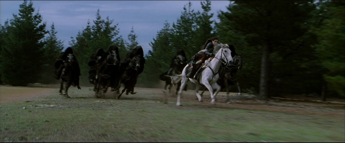 Arwen races away from the Dark Riders on the back of a beautiful white horse in The Fellowship of the Ring.