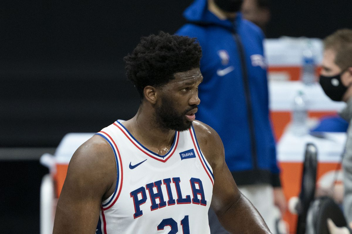 Philadelphia 76ers center Joel Embiid points to his basketball shorts during the fourth quarter against the Sacramento Kings at Golden 1 Center.