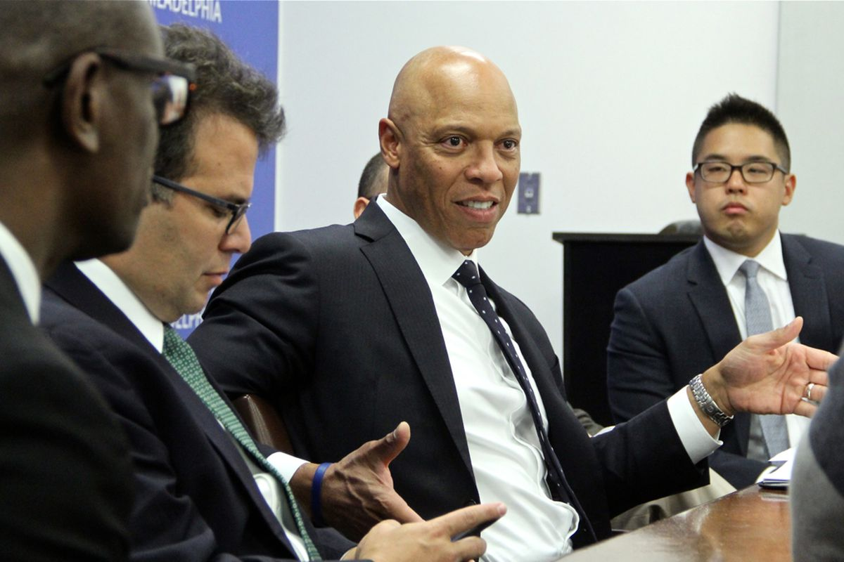 Philadelphia superintendent William Hite in a discussion with other school officials.