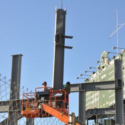 Steel beam being secured into position in right field -