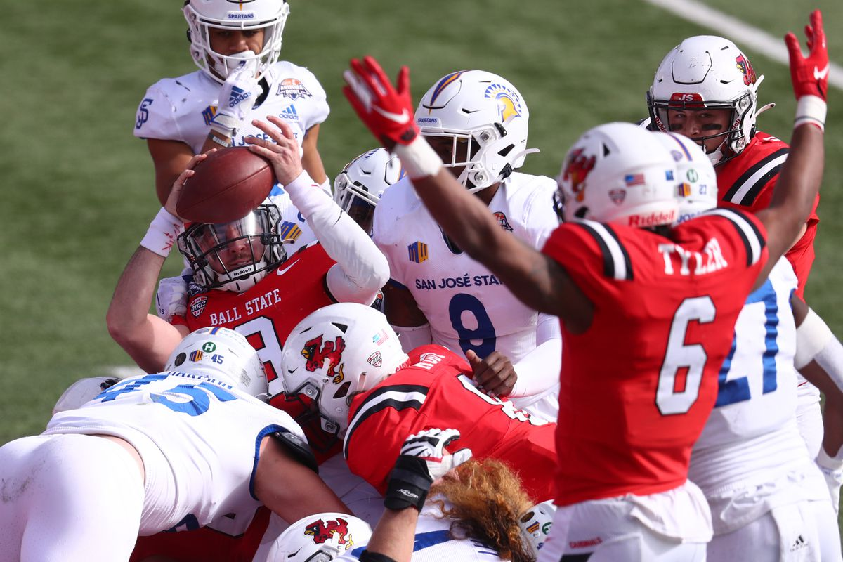 Ball State Cardinals quarterback Drew Plitt celebrates after scoring a touchdown against the San Jose State Spartans in the first half of the Arizona Bowl at Arizona Stadium.