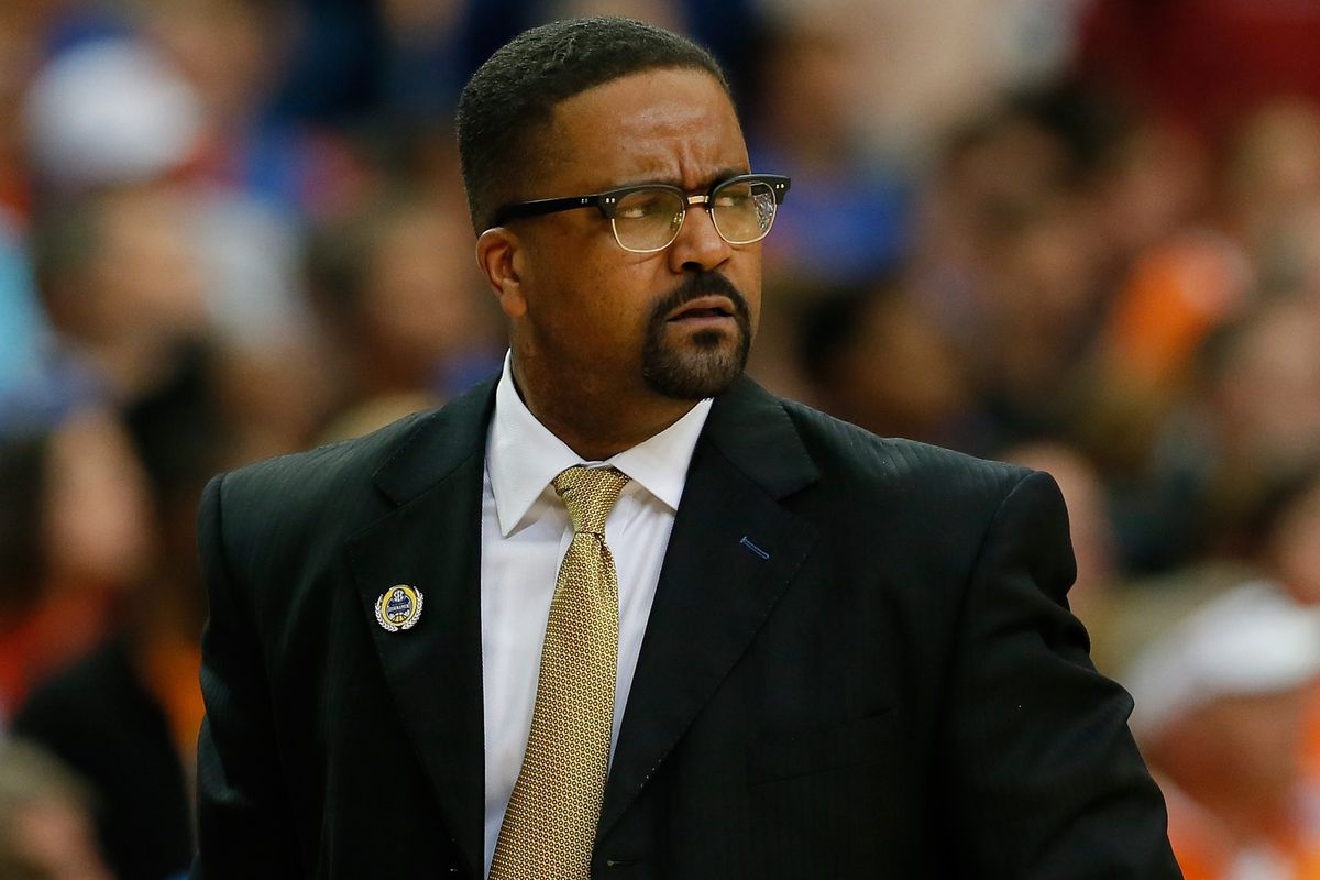 Frank Haith isn't amused to be sitting out today, either