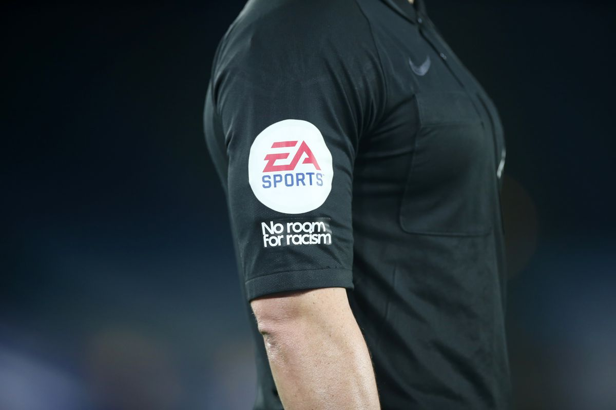 No room for racism and EA Sports badges on the sleeve of referee Lee mason during the Premier League match between Leicester City and Everton at The King Power Stadium on December 16, 2020 in Leicester, United Kingdom.