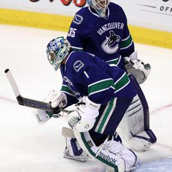 Vancouver Canucks goalies Roberto Luongo (1) and Cory Schneider (35) take part in a pregame skate before  Game 2 of first-round NHL Stanley Cup playoff hockey action against the Los Angeles Kings at Rogers Arena in Vancouver, British Columbia, Friday, April, 13, 2012.