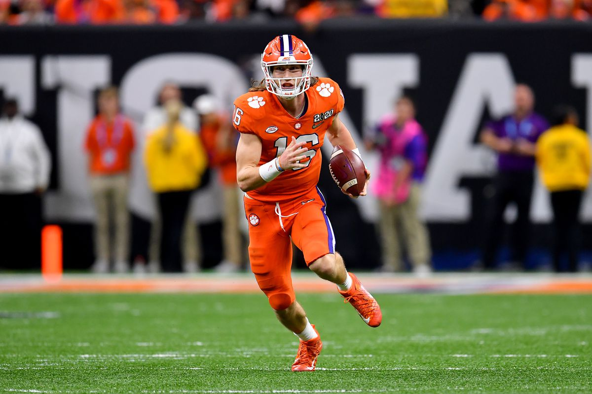 Trevor Lawrence of the Clemson Tigers runs with the ball during the fourth quarter of the College Football Playoff National Championship game against the LSU Tigers at the Mercedes Benz Superdome on January 13, 2020 in New Orleans, Louisiana.