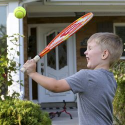 George Larsen tries to hit a tennis ball a he plays with his brother Peter at their home in Millcreek on Wednesday, Sept. 16, 2020.