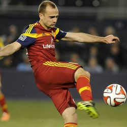 Real Salt Lake's Rich Balchan boots the ball during a game at Sporting Park in Kansas City, Kan., on Saturday, April 5, 2014.