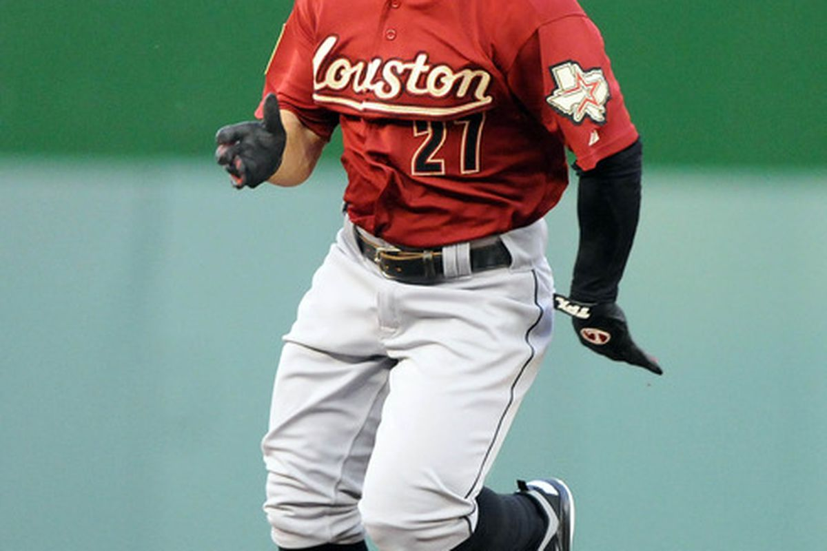 Apr 19, 2012; Washington, DC, USA; Houston Astros second baseman Jose Altuve (27) rounds second base after hitting a triple during the first inning against the Washington Nationals at Nationals Park. Mandatory Credit: Brad Mills-US PRESSWIRE