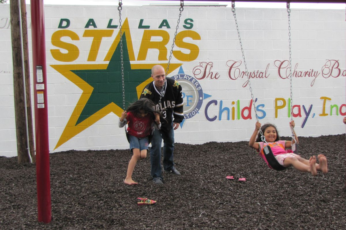Stephane Robidas plays with children at the opening of the new Dallas LIFE playground in May.