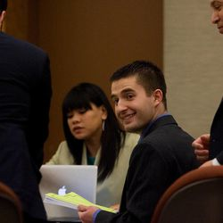 Martin Bond smiles while sitting with his attorneys on the first day of his trial in 4th District Court in American Fork Wednesday, Jan. 16, 2013. Bond is accused of killing former BYU professor Kay Mortensen in November 2009.