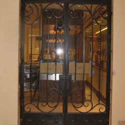 Iron wrought front door with glass inlay