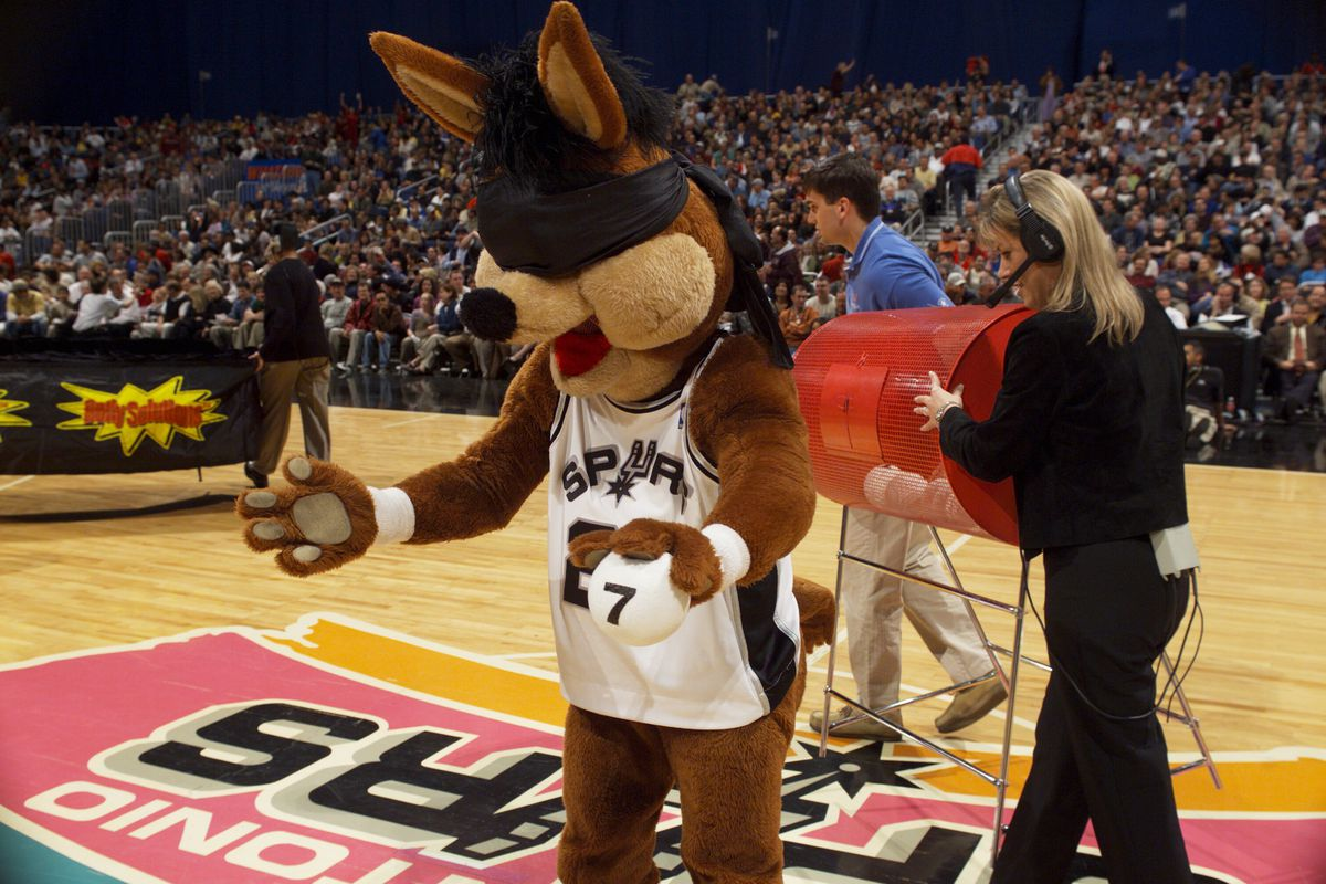 The Spurs Coyote draws the winning number 7 in a lottery to see which fans will receive a Coyote Bobblehead