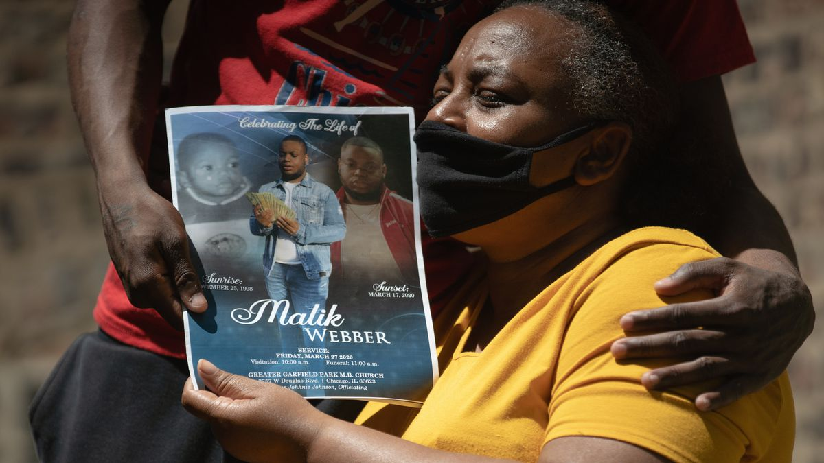 Angie Graves, at her home in North Lawndale, considered herself the adopted mom of Malik Webber, who killed himself in March. She holds the program for his funeral.
