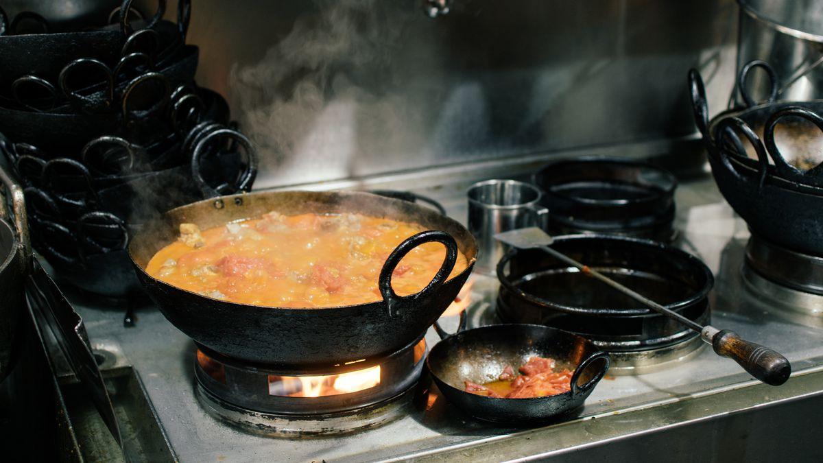 A wok of simmering lamb karahi at Namak Manda in Tooting