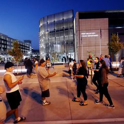 Protesters walk around after their demonstration at the West Valley City Police Department was disrupted by counterprotesters on Wednesday, Sept. 16, 2020.