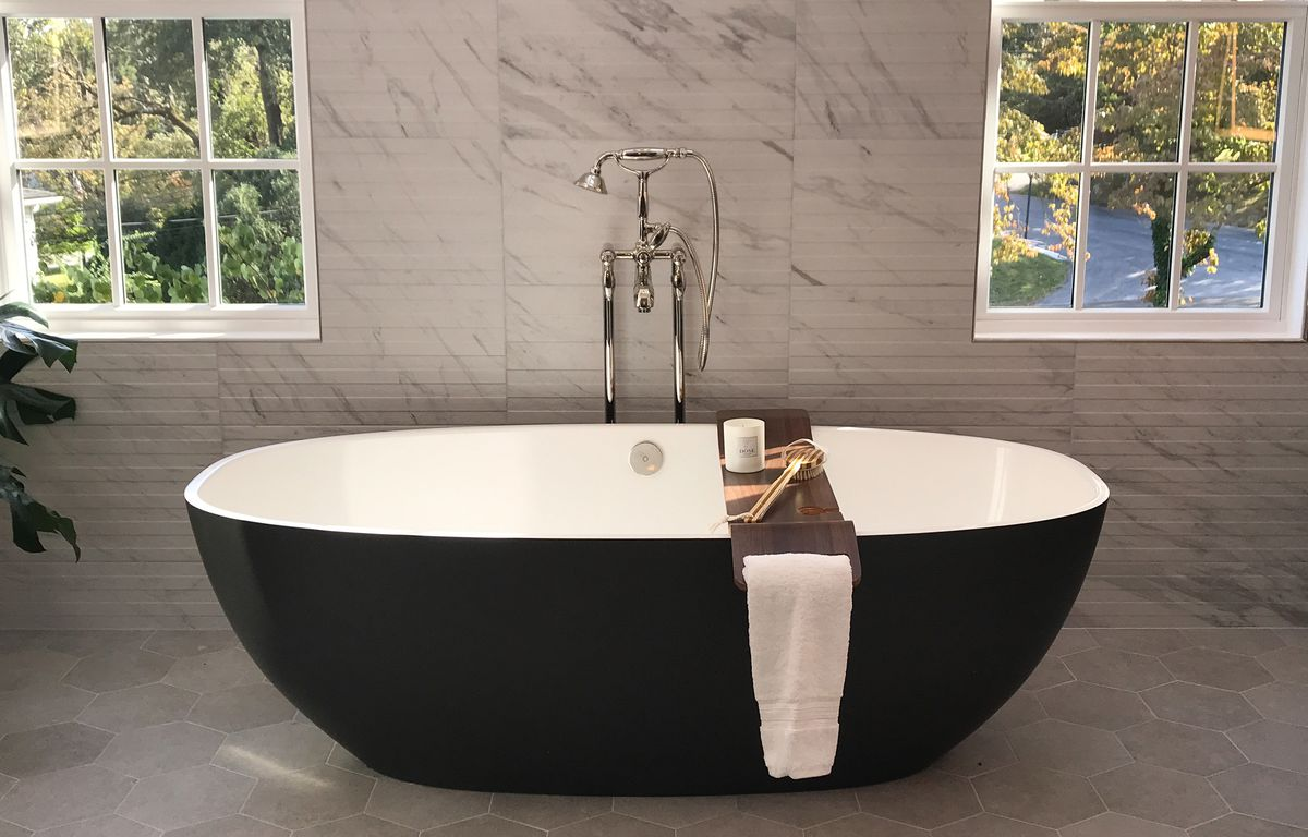 """<p><span style=""""font-size:18px""""><strong>Be Our Guest</strong></span></p> <p>Once our winners arrived, Robin from Karp Associates took the Insiders on their own exclusive tour of the interior before the doors opened to the public. The house contained innovative and funky features including a large master bathroom tub, a dog washing room, a rock-climbing wall in the children's room, and a glass ping-pong table.</p>"""