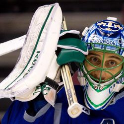 Vancouver Canucks' goalie Roberto Luongo adjusts his mask during hockey practice in Vancouver, British Columbia on Tuesday April 10, 2012. The Vancouver Canucks and Los Angeles Kings are scheduled to play game 1 of an NHL Western Conference quarterfinal series Wednesday.
