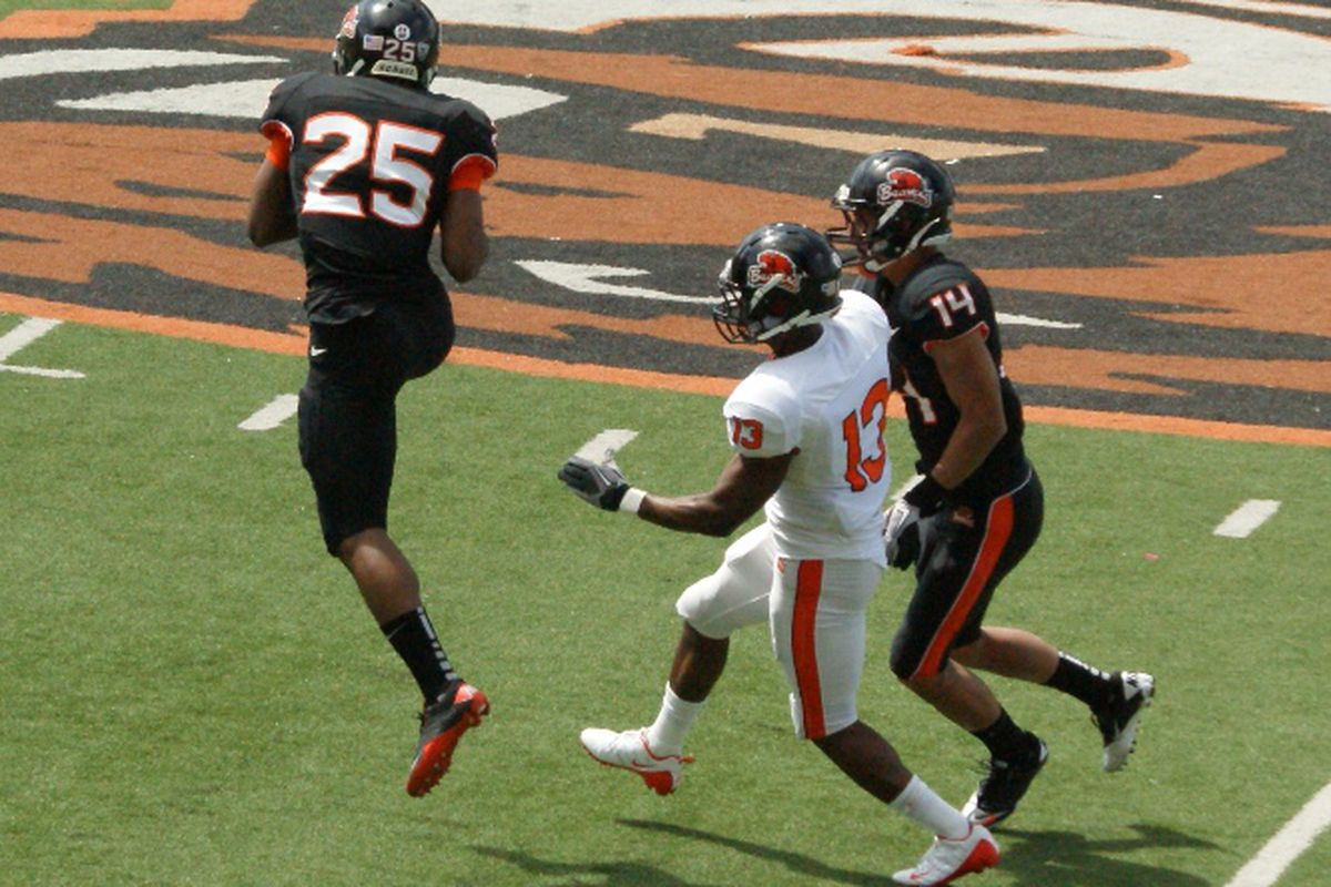 Ryan Murphy jumps in front of Brandin Cooks, who had encountered double coverage from Jordan Poyer, to make an interception on the 5th play of the Spring Scrimmage. <em>(Photo by Andy Wooldridge)</em>