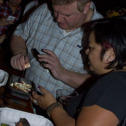 Jim Begley of the Las Vegas Weekly and Grace Bascos of Vegas Seven taste the dishes.