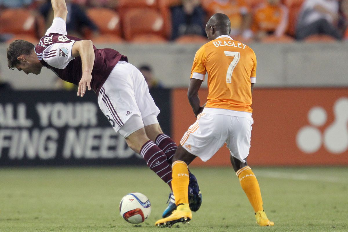Colorado Rapids player Dillon Powers is being challenged by Houston Dynamo Demarcus Beasley