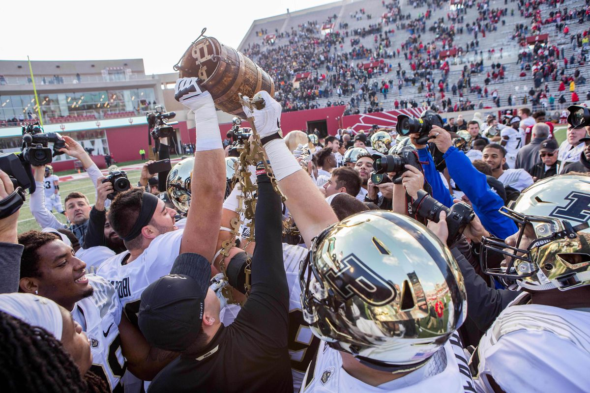 Purdue Boilermakers players hold up the old oak bucket after a game against the Indiana Hoosiers at Memorial Stadium.