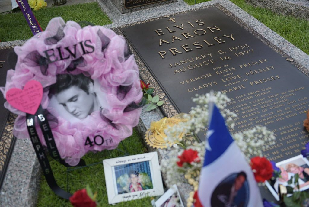 Tributes and mementos are seen next to the grave marker for Elvis Presley in the Meditation Garden where he is buried alongside his parents and grandmother at his Graceland mansion on August 12, 2017 in Memphis, Tennessee. | MANDEL NGAN/AFP/Getty Images