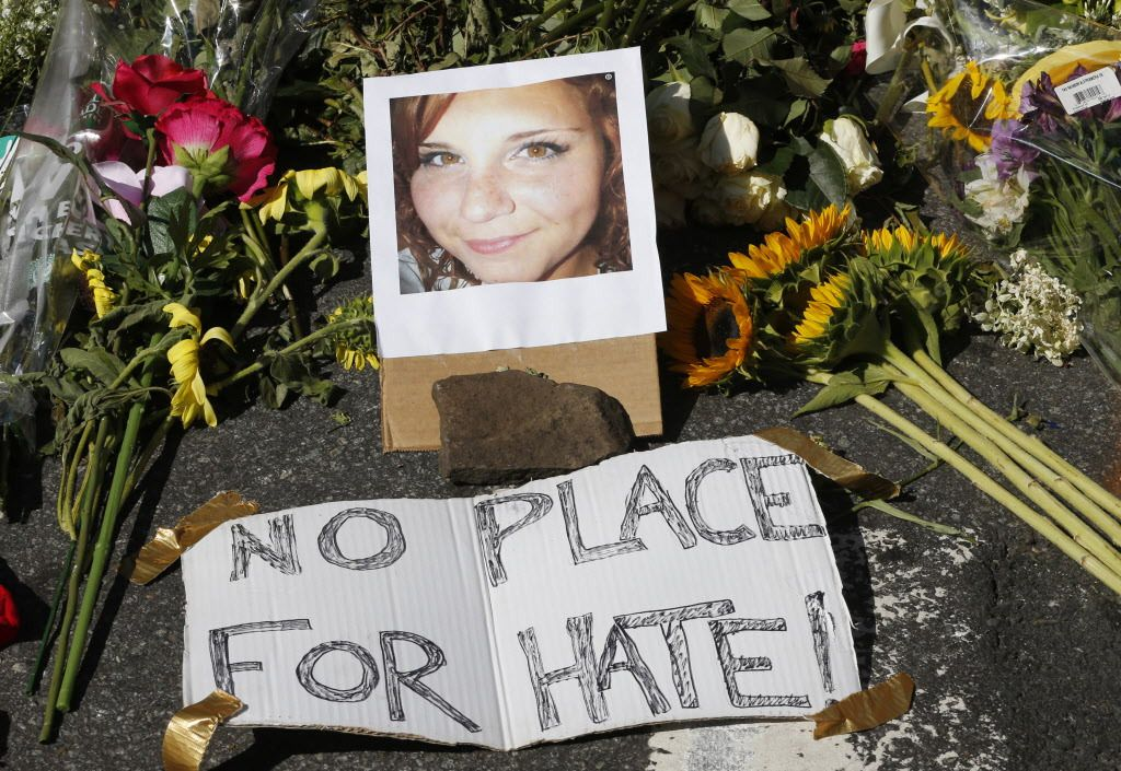 A makeshift memorial of flowers and a photo of victim Heather Heyer, sits in Charlottesville, Virginia, on Sunday, Aug. 13, 2017. Heyer died when a car rammed into a group of people who were protesting the presence of white supremacists who had gathered i