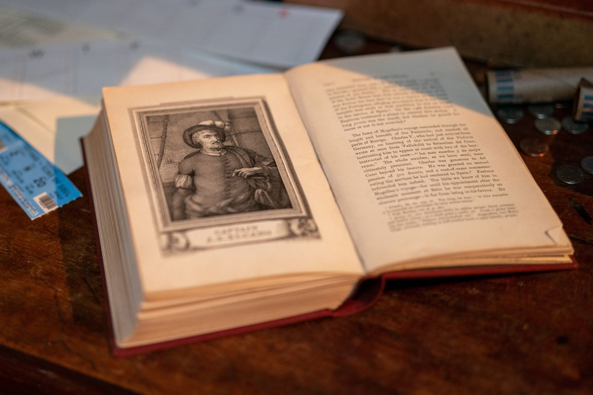 a book about Ferdinand Magellan from the set of the Uncharted movie