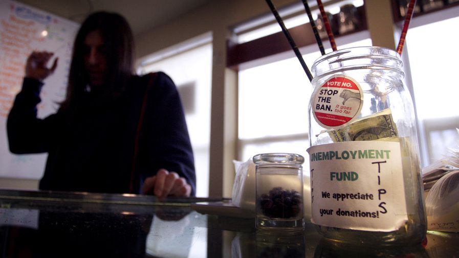 A worker at Fort Collins' Medicinal Gardens dispensary, one of 23 facing a Tuesday deadline for closure. Photo by Joe Mahoney / I-News