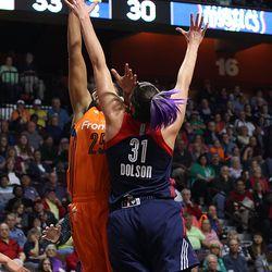Connecticut Sun's Alyssa Thomas (25) is fouled by Washington Mystics' Stefanie Dolson (31).