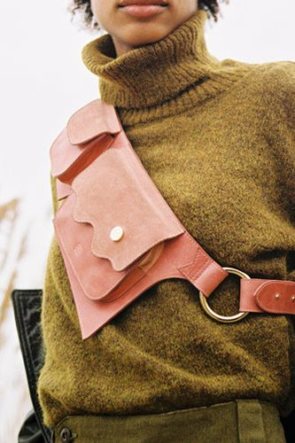 A pink leather fanny pack belt by Ashya