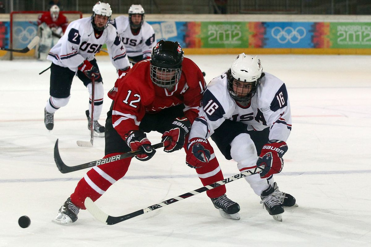North Dakota recruit Nick Schmaltz battles for a loose puck in a game against Team Canada from 2012.