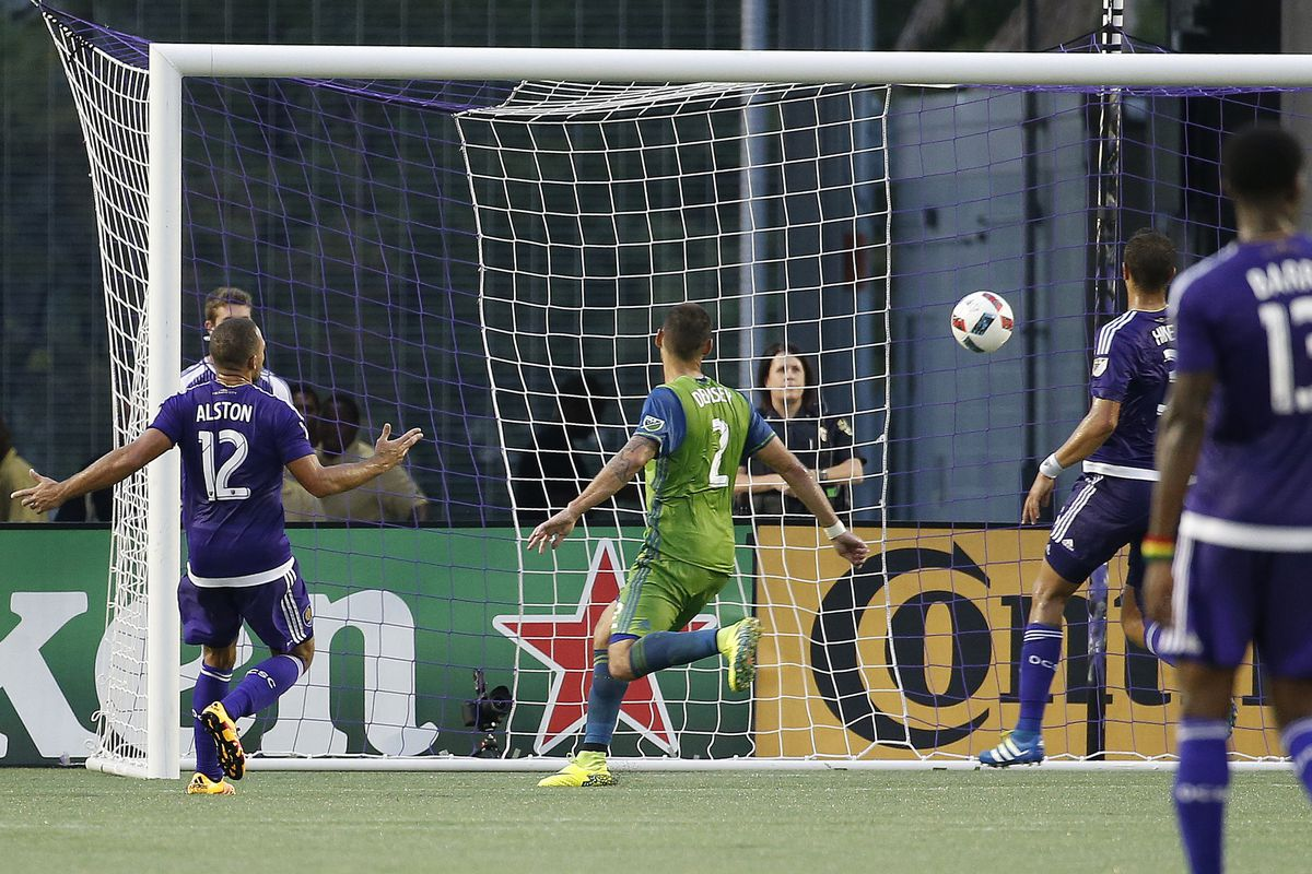 Clint Dempsey watches the ball go in the net.