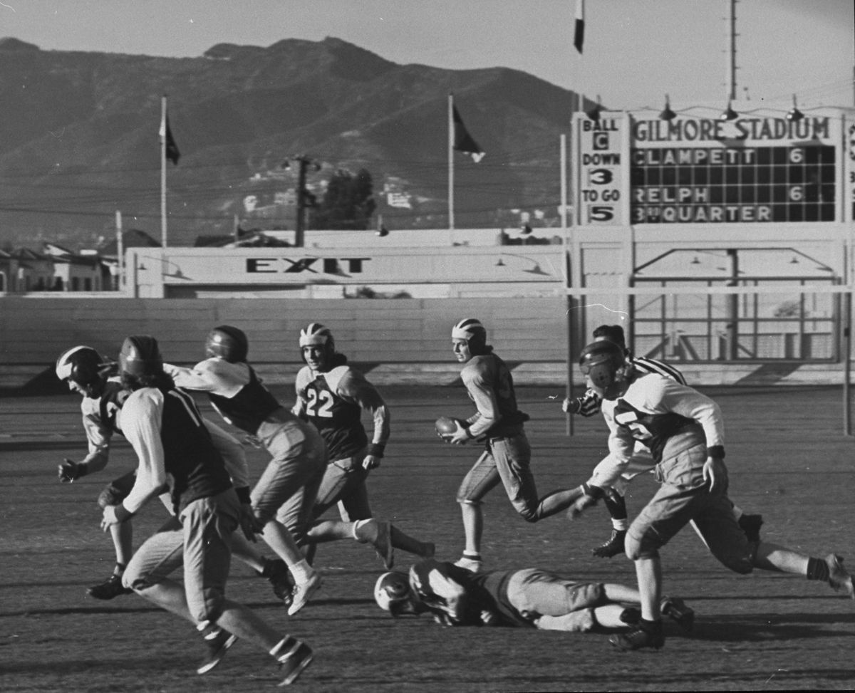 Women play in a 1939 football game at a stadium in Southern California.