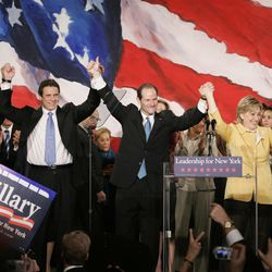 From left, New York Democratic candidates Lt. Governor David Paterson, Attorney General Andrew Cuomo, gubernatorial candidate Eliot Spitzer, and U.S. Senator Hillary Clinton celebrate their victory in the midterm elections in New York, Tuesday, Nov. 7, 2006.