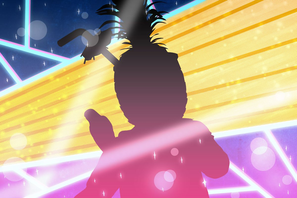 Silhouette of a performer wearing an oversize pineapple mask