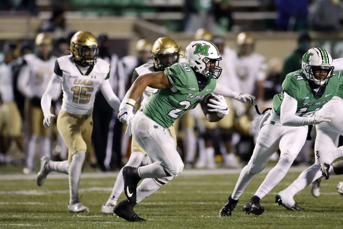 Brenden Knox #20 of the Marshall Thundering Herd runs the ball against the UAB Blazers in the second half of the Conference USA Championship at Joan C. Edwards Stadium on December 18, 2020 in Huntington, West Virginia. UAB defeated Marshall 22-13.